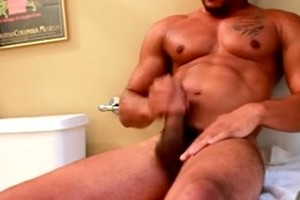 Muscle ebony man Lawson Kane strokes his cock